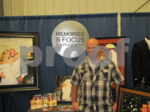 "Troy Schroeder at his booth ""Memories in Focus"" at The Messenger's Bridal Show."