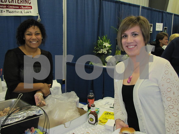 Danica Mosley of Howard Ball Feed Shed Catering offered samples and information to Amy Nervig at The Messenger's Bridal Show.