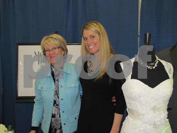 "Sheri and Ashley Reutter at their booth for ""Modern Dress"" in Boone."