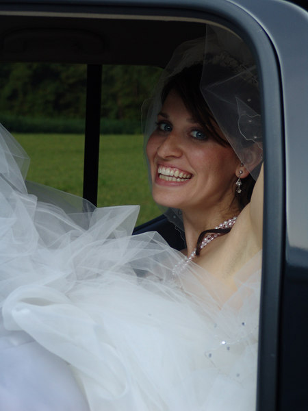 Summer & her dress packed into the back seat of the truck, after the ceremony.