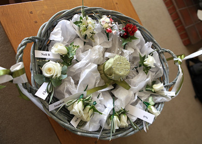 Buttonholes delivered to a brides parents house before a wedding ceremony at Bury Cathedral followed by a wedding reception at Haughley Park Barn