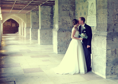A bride and groom in the cloisters at Bury Cathedral on their wedding day