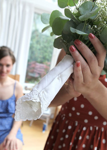 A brides grandmothers handkerchief wrapped around the brides bouquet on her wedding day