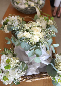 The brides and bridesmaids bouquets delivered to the brides parents house before a wedding ceremony at Bury Cathedral followed by a wedding reception at Haughley Park Barn