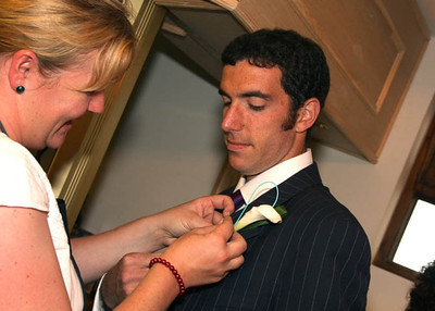 Buttonholes being put on for a wedding at Dairy Barns