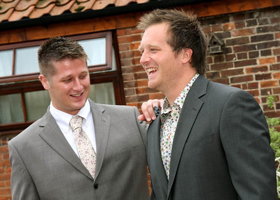 An excited groom and his bestman at his wedding at Dairy Barns