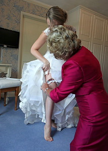 A bride getting ready with her mum for her wedding ceremony at Ixworth Church followed by a wedding reception at Blackthorpe Barn