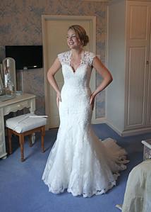 A bride getting ready for her wedding ceremony at Ixworth Church followed by a wedding reception at Blackthorpe Barn