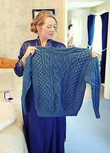 A bride knitted her groom an arran jumper in his family name's pattern as a wedding present on their wedding day