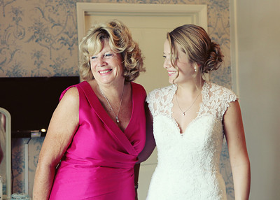 A bride and her mum at home before her wedding ceremony at Ixworth Church followed by a wedding reception at Blackthorpe Barn