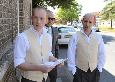 The ushers for a wedding coming to collect buttonholes from the brides mums house