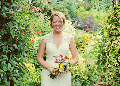 A bride in her mum's garden on her wedding day before her wedding ceremony at Ixworth Church and Wedding reception at Blackthorpe Barn
