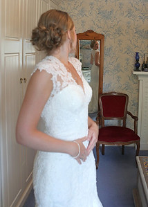 A bride getting ready for her wedding ceremony at Ixworth Church followed by a wedding reception at Blackthorpe Barn
