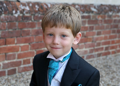 A cute pageboy at a wedding at Spains Hall
