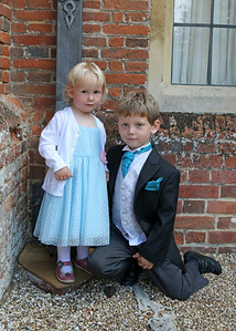 A pageboy and his little sister at a wedding at Spains Hall