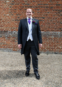 A groom before his wedding in the Elizabethan Hall at Spains Hall