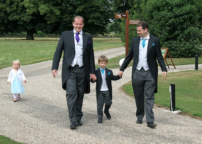 The groom and bestman with the bestman's son who was a pageboy at a wedding at Spains Hall