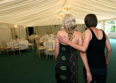 A bride and one of her bridesmaids looking at the marquee set up for her wedding at the Fennes during her getting ready