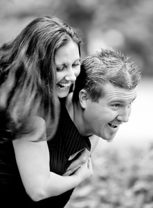 Scott takes Krista for a ride in this fun shot taking during their engagement portrait session at a Denver University garden .