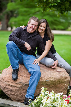 Krista and Scott pose during their engagement portrait session at a Denver University Garden.