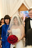 The bride (Tricia Weiler) is escorted down the aisle by her parents (R. and Mrs. Darryl Weiler).