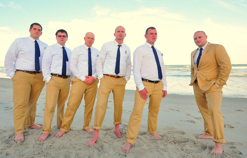Wedding Photographer Bryce Lafoon, captures a groom and his groomsmen during a beach wedding at TopSail Island, NC.