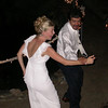 Action during the first dance, bride and groom having a blast.