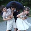 groom plays around with kids.