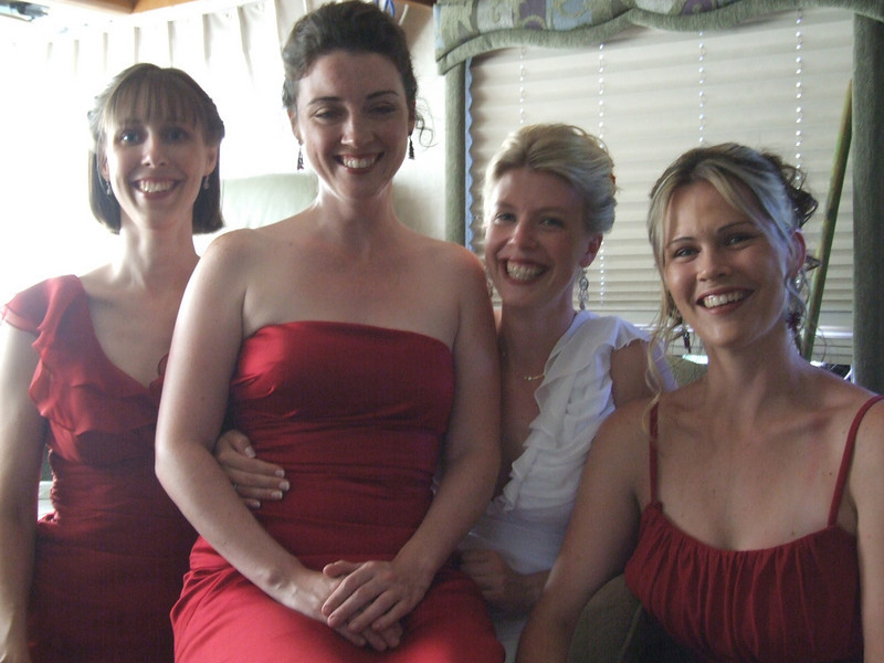 Bride with the Maid of Honor and Bridesmaids getting ready in the RV.