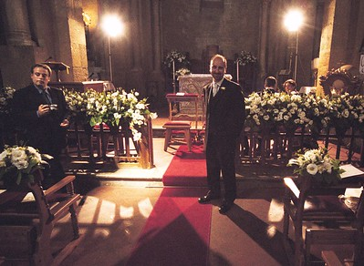 Waiting at the altar for his bride.