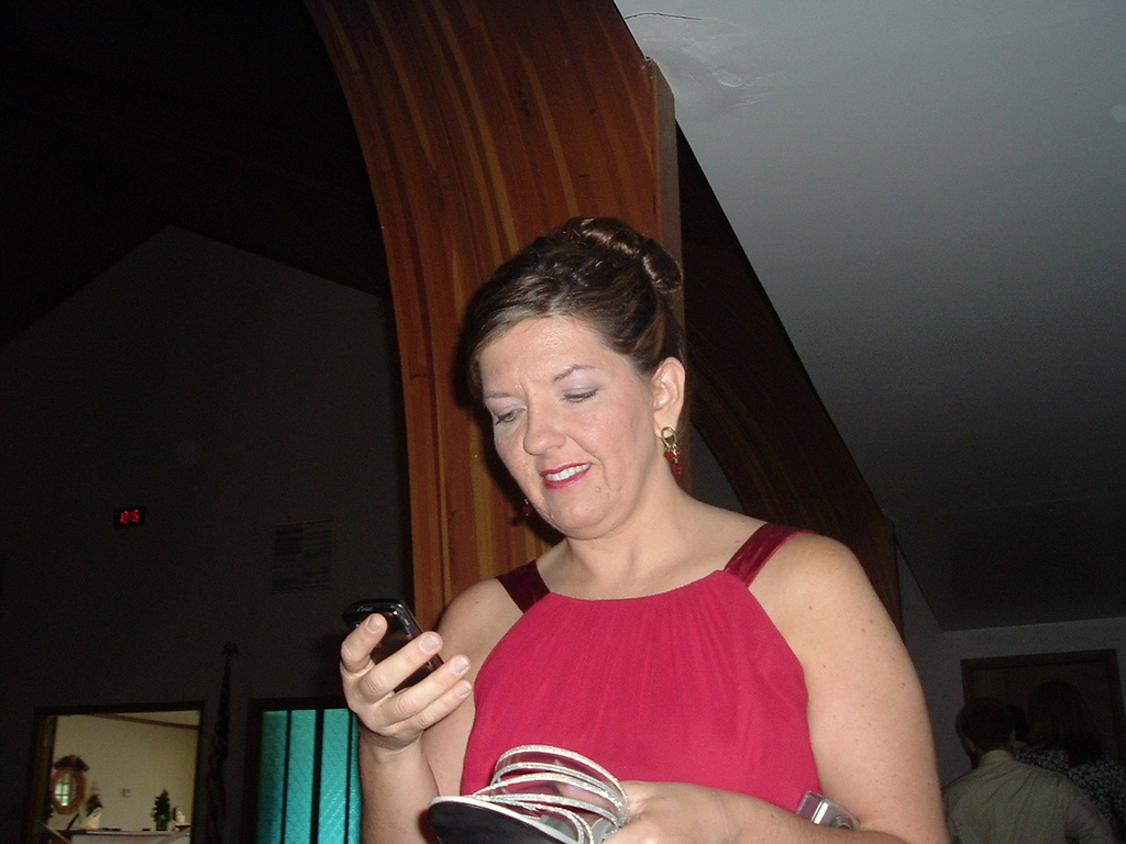 Krista Caveny - Maid of Honor<br /> Is that a shoe phone?