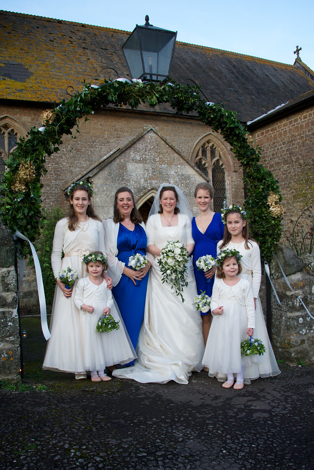 bride and bridesmaids outsdie church