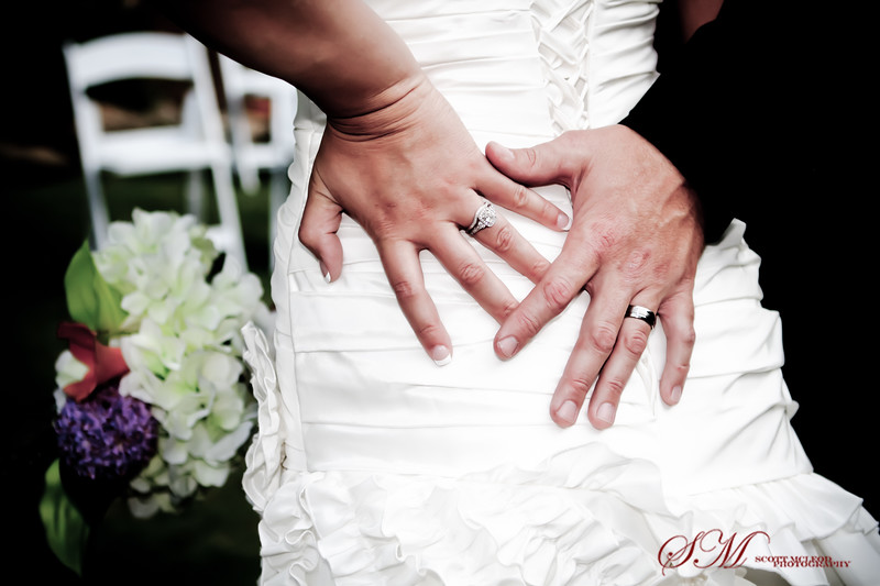 Hands, rings, flowers and dress
