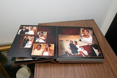 LFM - Leather cover, corners of pages are rounded, thicker pages, cut center-line between pages, comes in a presentation box, some consider it more formal.  Layouts and designs seen will vary for each client created uniquely by our album designer.