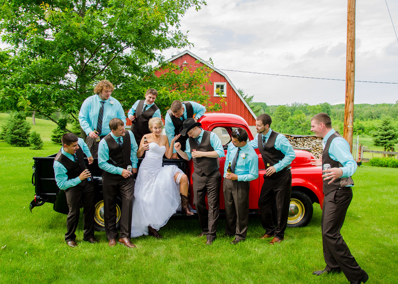 holt wedding bride with groomsman on truck