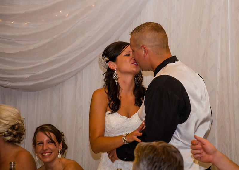 Risa wedding reception kiss