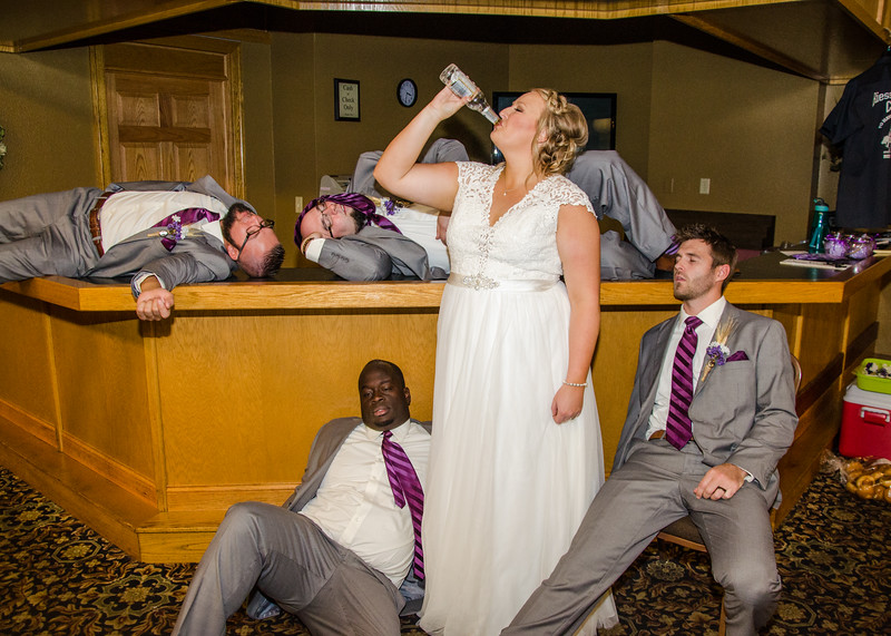 Riess wedding bride drinking groomsmen under table