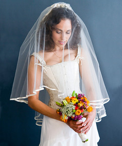 photography by Rob Perica, hairstyling by Wiyanna Oakley, makeup by Madeline McCaffrey, wedding dress by Alexandria von Bromssen