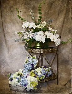 Altar arrangement with flowing bridal bouquets