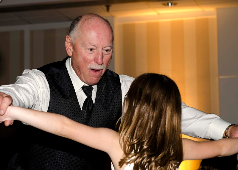 Photo of grandfather and granddaughter at wedding reception at the Sheraton Brookfield.