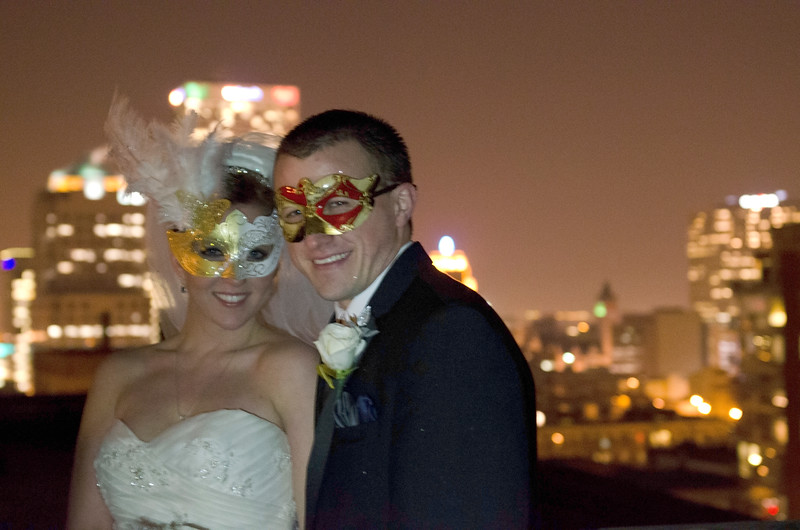 Wedding photo of the Milwaukee cityscape on the rooftop of the Astor Hotel Milwaukee.