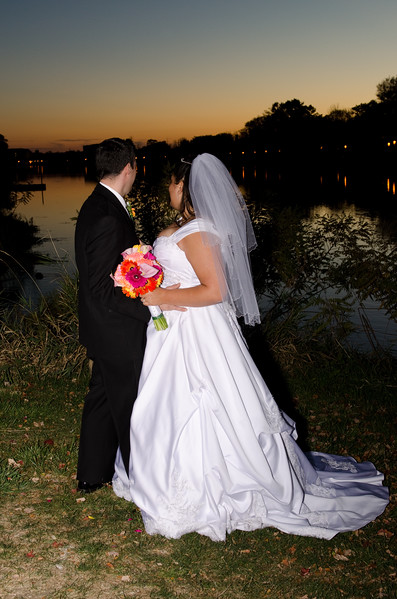 Bride and groom overlooking the Fox River at Frame Park in Waukesha during the sunset.