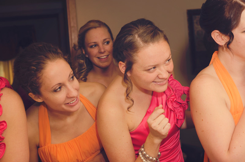 Bridesmaids getting a first look of the their friend at the Rotunda Waukesha.