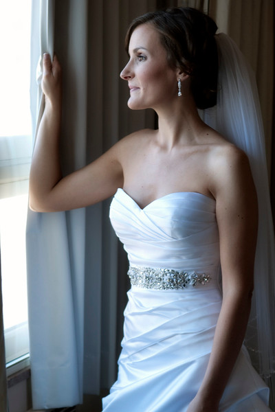 Bride looking out the window at Hotel Metro Milwaukee