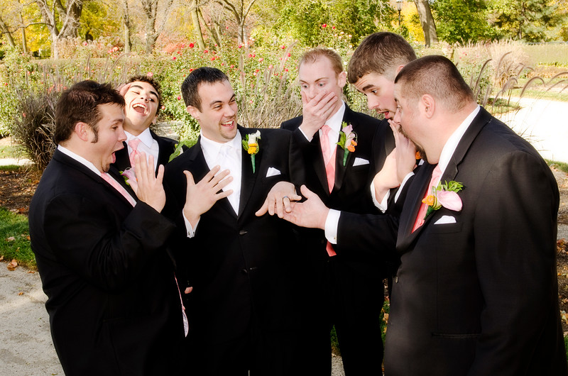Groomsmen posing with feigned reactions at Frame Park Waukesha.