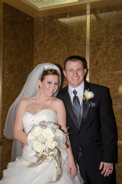 Another candid wedding photo at the elevators of the Astor Hotel Milwaukee.