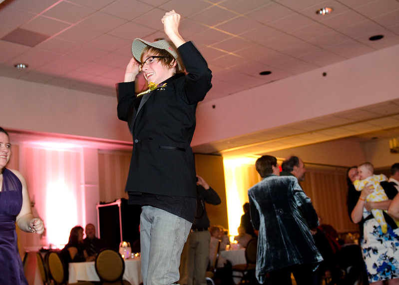 Photo of wedding guest jumping excitedly into the air during the reception at the Sheraton Brookfield.