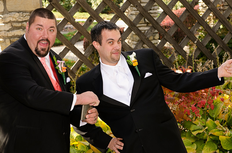 Fun wedding photo of groom and best man at the gardens in Frame Park Waukesha.