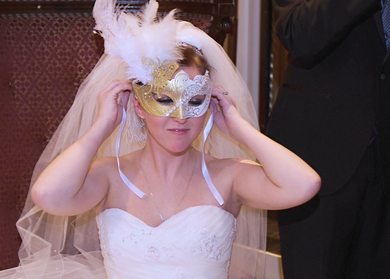 Bride with masquerade mask.