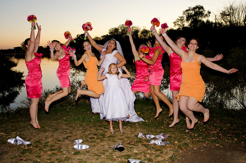 Bridal party jumping in the air at Frame Park Waukesha.